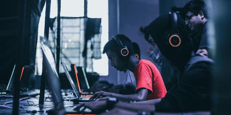 men playing video games on laptop